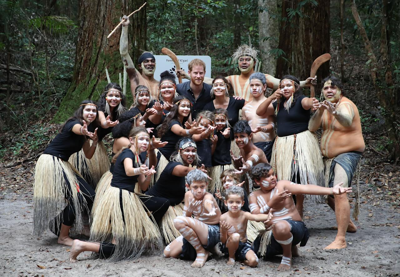 <p>Prince Harry posed for pictures with the members of the Butchulla people, who are the traditional owners of Fraser Island. Photo: Getty Images </p>