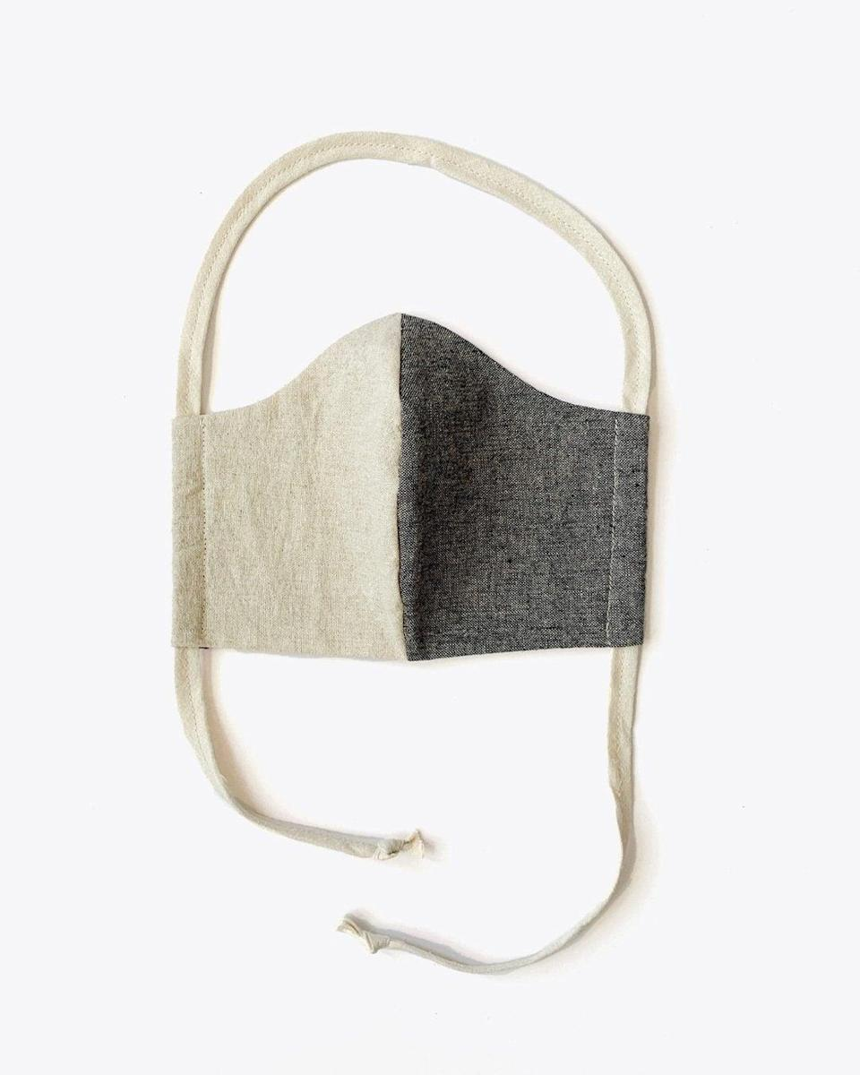 """<h3><a href=""""https://fave.co/3cdK6LD"""" rel=""""nofollow noopener"""" target=""""_blank"""" data-ylk=""""slk:Nisolo Upcycled Linen & Cotton Lined Mask"""" class=""""link rapid-noclick-resp"""">Nisolo Upcycled Linen & Cotton Lined Mask</a></h3> <br>Handmade by the local Nashville artist behind the apparel company <a href=""""https://emleedesign.com/"""" rel=""""nofollow noopener"""" target=""""_blank"""" data-ylk=""""slk:Emlee"""" class=""""link rapid-noclick-resp"""">Emlee</a>, these masks feature a trendy <a href=""""https://www.refinery29.com/en-us/two-tone-color-trend"""" rel=""""nofollow noopener"""" target=""""_blank"""" data-ylk=""""slk:two-tone pattern"""" class=""""link rapid-noclick-resp"""">two-tone pattern</a> cut to fit your face. Each mask is hand-sewn by local seamstresses using deadstock linen, cotton, and hemp fabrics and lined with 100% USA-made cotton twill for comfort. <br><br><strong>EMLEE</strong> Upcycled Linen & Cotton Lined Mask, $, available at <a href=""""https://go.skimresources.com/?id=30283X879131&url=https%3A%2F%2Ffave.co%2F3cdK6LD"""" rel=""""nofollow noopener"""" target=""""_blank"""" data-ylk=""""slk:Nisolo"""" class=""""link rapid-noclick-resp"""">Nisolo</a><br>"""