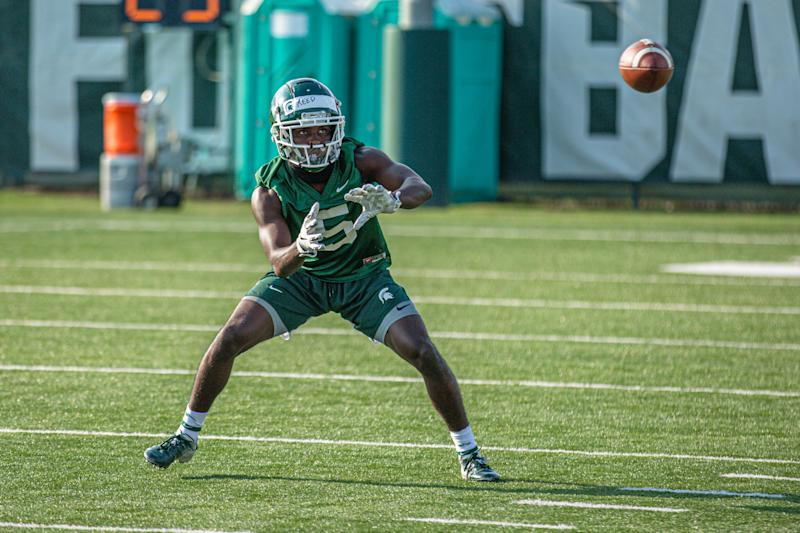 Michigan State wide receiver Jayden Reed eyes a pass during an August practice in East Lansing.