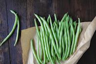 """<p>Fresh green beans should be strong and vibrant; ideally, they'll snap when you bend them. But store them wrong and you could end up with a bendy, brown strand instead of one of <a href=""""https://www.thedailymeal.com/eat/popular-vegetable-us-states?referrer=yahoo&category=beauty_food&include_utm=1&utm_medium=referral&utm_source=yahoo&utm_campaign=feed"""" rel=""""nofollow noopener"""" target=""""_blank"""" data-ylk=""""slk:America's favorite vegetables"""" class=""""link rapid-noclick-resp"""">America's favorite vegetables</a>. Keep your green beans in an unsealed plastic bag wrapped in a paper towel. Place the bag in your refrigerator's crisper drawer.</p>"""