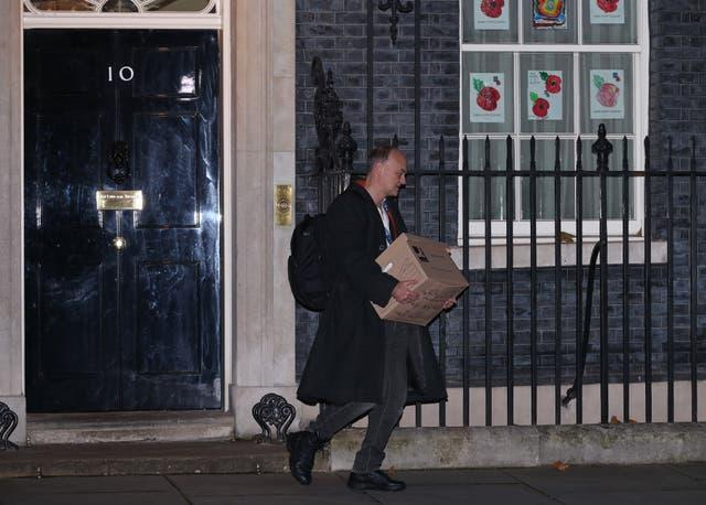 Dominic Cummings leaves 10 Downing Street, London, with a box (Yui Mok/PA)