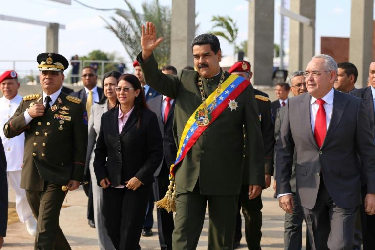 Venezuelan President Nicolas Maduro (C) greets supporters before a public event in Puerto Ordaz, east of Caracas, on April 11, 2017