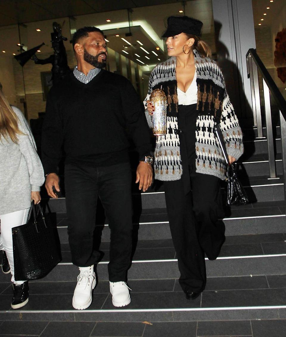 <p>Lopez was photographed on October 23 Los Angeles, California wearing a rather 00s-inspired look. For the outing she teamed a black baker boy style cap with an oversized knitted cardigan, a V-neck white top, high-waisted black flared trousers and black hoop earrings.</p><p>The singer also carried a gigantic coffee cup, bedazzled in gold and silver embellishments. </p>