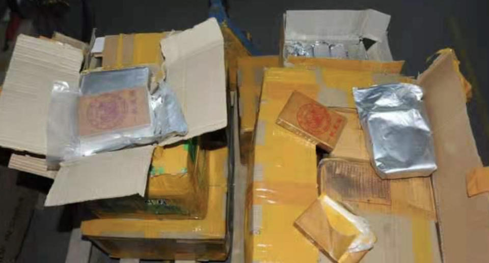 Packages of heroin seized by Australian Federal Police are pictured.