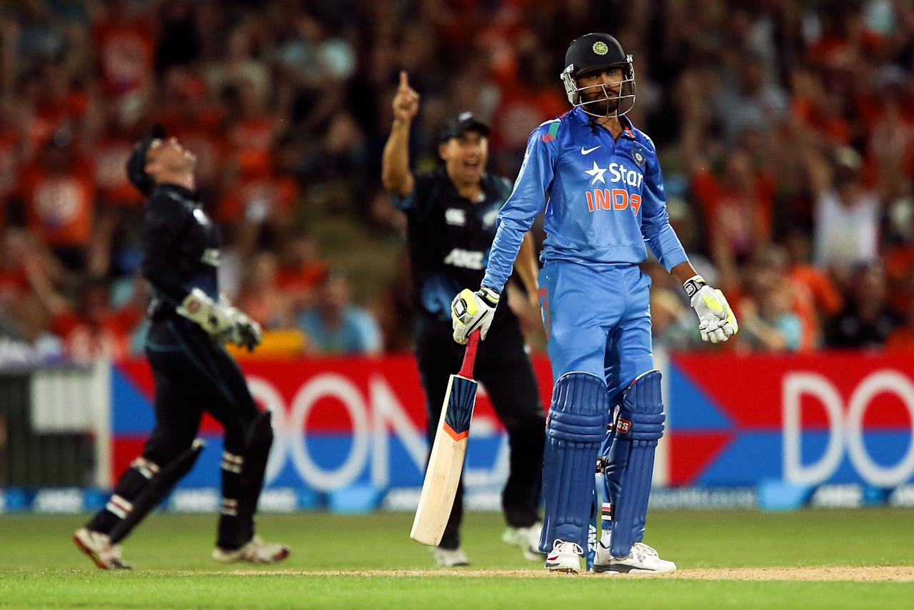 NAPIER, NEW ZEALAND - JANUARY 19:  Ravindra Jadeja of India reacts after being dismissed during the first One Day International match between New Zealand and India at McLean Park on January 19, 2014 in Napier, New Zealand.  (Photo by Hagen Hopkins/Getty Images)