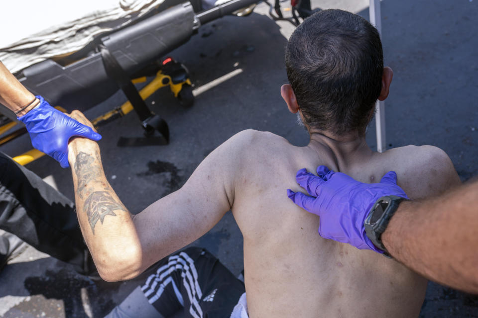 Salem Fire Department paramedics respond to a heat exposure call at a cooling center during a heat wave, Saturday, June 26, 2021, in Salem, Ore. (AP Photo/Nathan Howard)