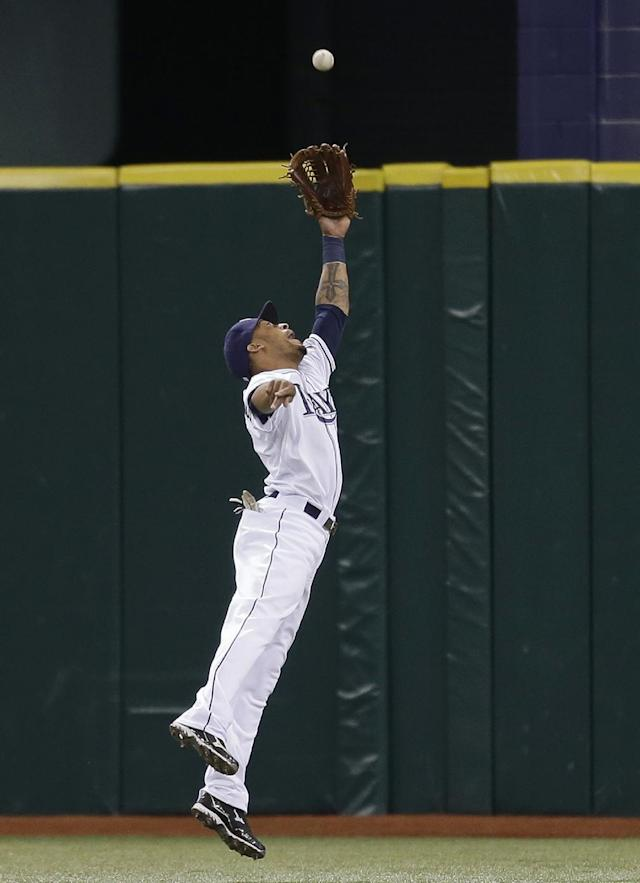 Tampa Bay Rays center fielder Desmond Jennings leaps but has a second-inning, two-run triple by Texas Rangers' Leonys Martin go over his head during an MLB American League baseball game Wednesday, Sept. 18, 2013, in St. Petersburg, Fla. Rangers' Mitch Moreland and Jurickson Profar scored on the hit. (AP Photo/Chris O'Meara)
