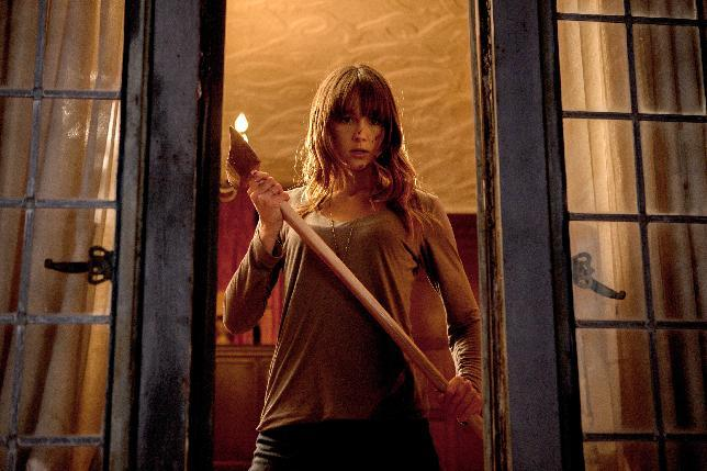 """This film publicity image released by Lionsgate shows Sharni Vinson in a scene from """"You're Next."""" (AP Photo/Lionsgate, Corey Ransberg)"""