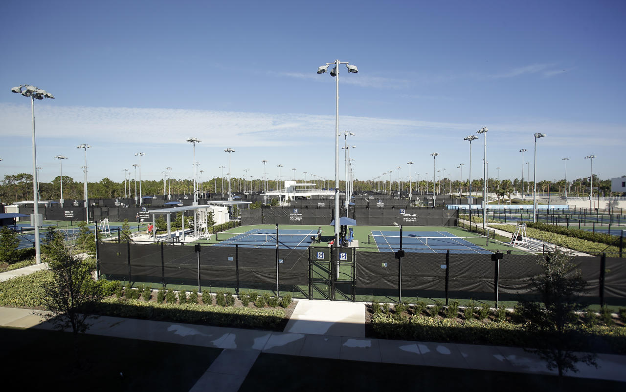 "In this Tuesday, Dec. 12, 2017, photo, some of the 100 tennis courts that are available to players are seen at the USTA National Campus in Orlando, Fla. It's where dozens of professional players from the country, including U.S. Open runner-up Madison Keys, went through preseason preparations with an eye on the Australian Open. On Thursday, Keys reached the third round with a victory, as did 97th-ranked Tennys Sandgren, who upset 2014 champion Stan Wawrinka. Back in December, the two Americans practiced a few courts away from each other at the campus, with a ""Team USA"" label on the nearby fence.(AP Photo/John Raoux)"