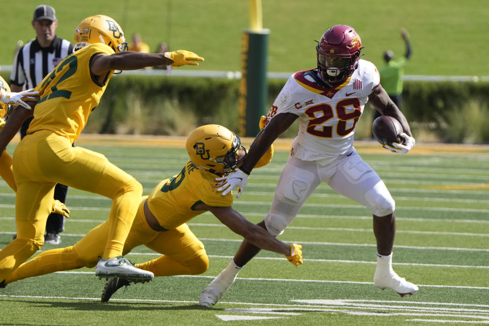 Iowa State running back Breece Hall (28) runs past Baylor safety Jalen Pitre (8) during the first half of an NCAA college football game, Saturday, Sept. 25, 2021, in Waco, Texas. (AP Photo/Jim Cowsert)