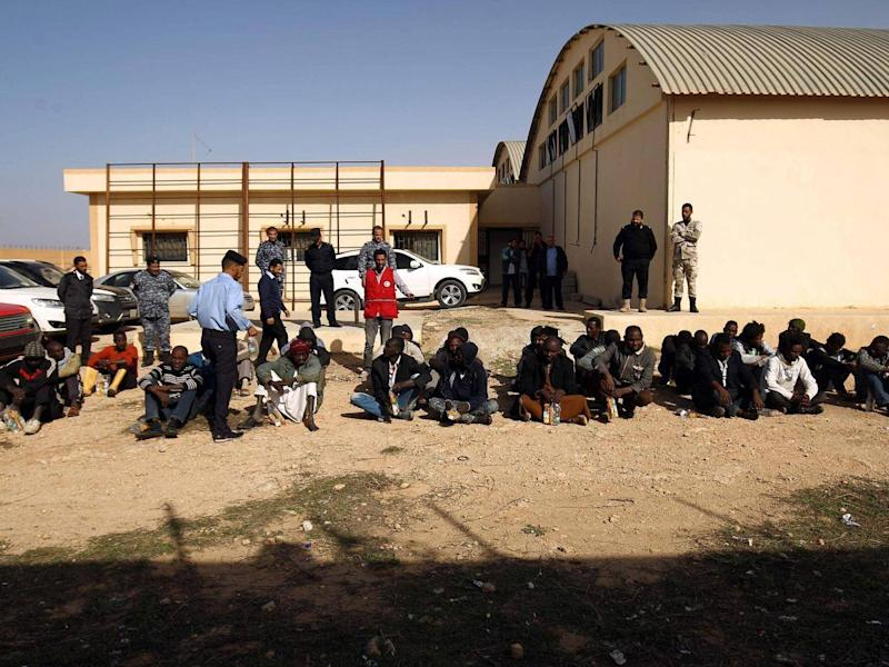 Sub-Saharan migrants sit at the Qanfouda detention centre, in the southern outskitrs of Benghazi (Getty)