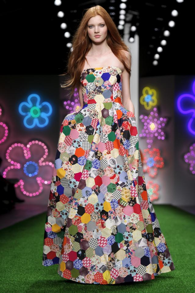A model wears a design from the Jasper Conran Spring/Summer 2013 collection during London Fashion Week, Saturday, Sept. 15, 2012. (AP Photo/Jonathan Short)