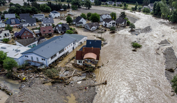 Image: Damaged houses are seen at the Ahr river in Insul, western Germany (Michael Probst / AP)