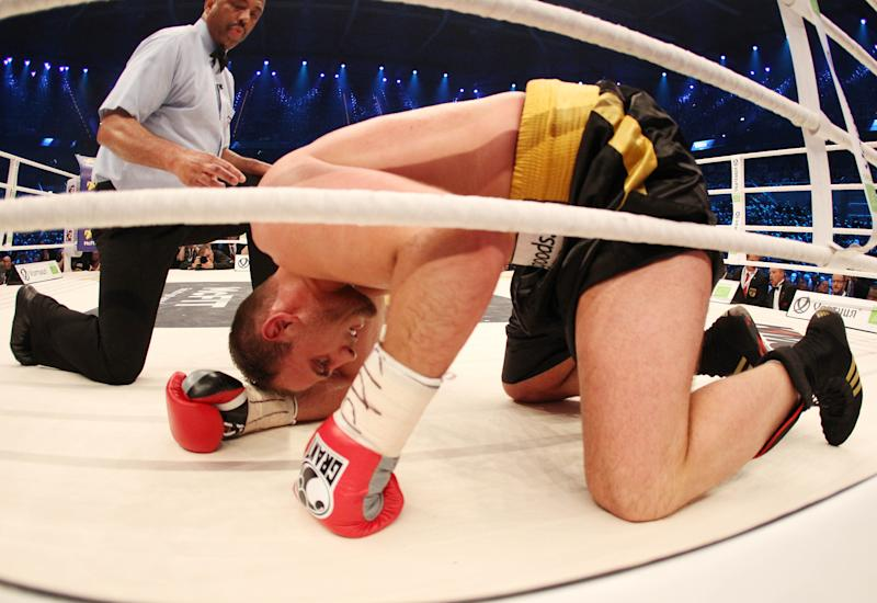 German-Italian boxer Francesco Pianeta kneels in the ring after he was knocked out by Ukranian Wladimir Klitschko in a WBA-, IBF,- WBO- and IBO heavyweight world championship fight in Mannheim, Saturday, May 4, 2013.(AP Photo/Michael Probst)