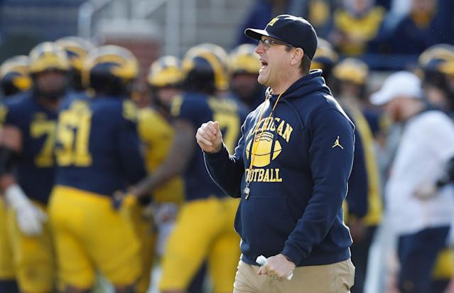 Michigan head coach Jim Harbaugh watches the team's annual spring NCAA college football game, Saturday, April 13, 2019, in Ann Arbor, Mich. (AP Photo)