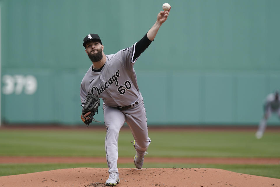 Chicago White Sox's Dallas Keuchel delivers a pitch against the Boston Red Sox in the first inning of a baseball game, Sunday, April 18, 2021, in Boston. (AP Photo/Steven Senne)
