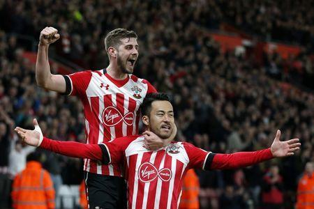 Britain Soccer Football - Southampton v Crystal Palace - Premier League - St Mary's Stadium - 5/4/17 Southampton's Maya Yoshida celebrates scoring their second goal with Jack Stephens Action Images via Reuters / Matthew Childs Livepic