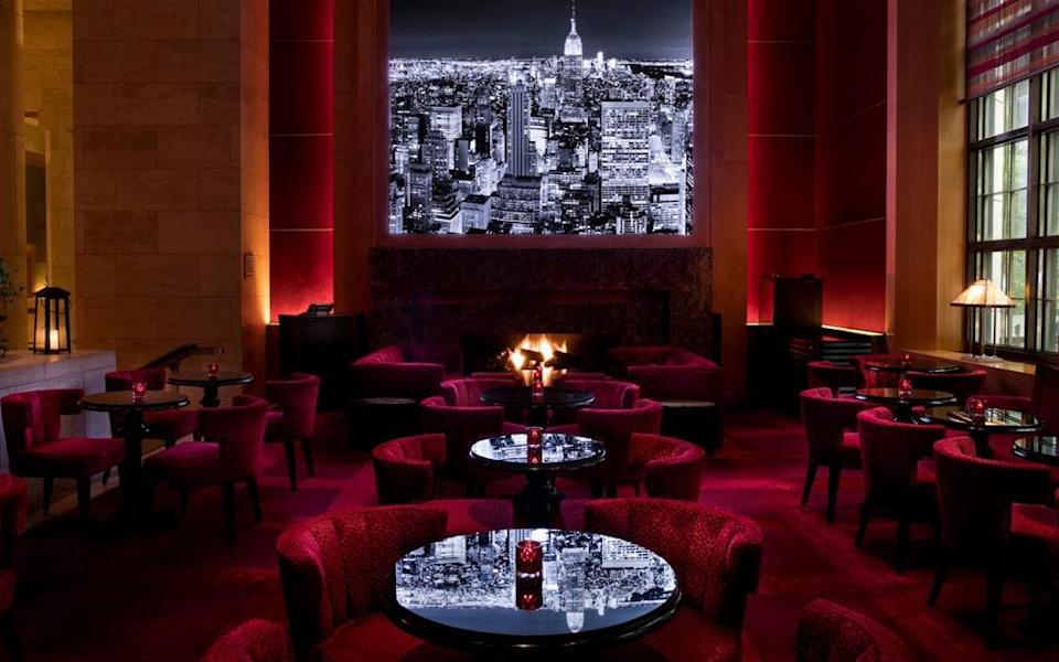 The Four Seasons Hotel New York is palatial but cosy furnishings and hum from the bar helps retain a degree of intimacy