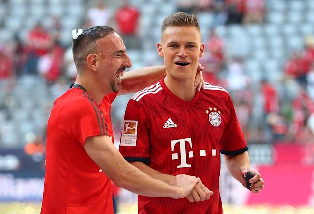 Soccer Football - Bundesliga - Bayern Munich v VfB Stuttgart - Allianz Arena, Munich, Germany - May 12, 2018 Bayern Munich's Franck Ribery and Joshua Kimmich as they celebrate winning the Bundesliga REUTERS/Michael Dalder DFL RULES TO LIMIT THE ONLINE USAGE DURING MATCH TIME TO 15 PICTURES PER GAME. IMAGE SEQUENCES TO SIMULATE VIDEO IS NOT ALLOWED AT ANY TIME. FOR FURTHER QUERIES PLEASE CONTACT DFL DIRECTLY AT + 49 69 650050
