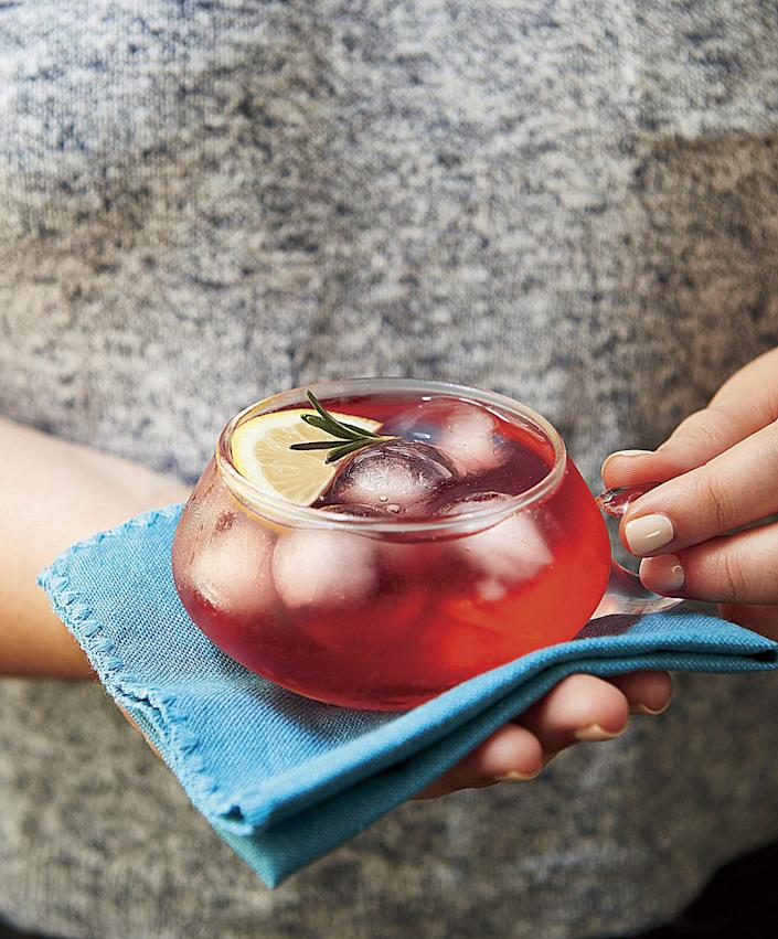 """<p><strong>Recipe: </strong><a href=""""https://www.southernliving.com/recipes/thanksgiving-rum-punch"""" rel=""""nofollow noopener"""" target=""""_blank"""" data-ylk=""""slk:Thanksgiving Punch"""" class=""""link rapid-noclick-resp""""><strong>Thanksgiving Punch</strong></a></p> <p>Kick off your Turkey Day with a cup of chilled, spiced punch that looks beautiful, too. </p>"""
