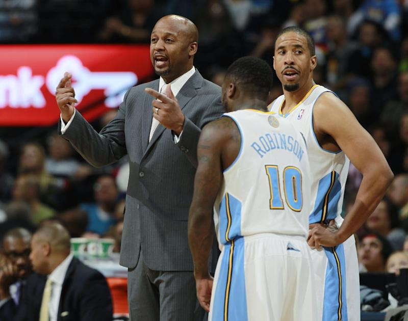 Denver Nuggets head coach Brian Shaw, left, confers with guards Nate Robinson, front right, and Andre Miller during a time out against the Utah Jazz in the fourth quarter of Utah's 103-93 victory in an NBA basketball game in Denver on Friday, Dec. 13, 2013