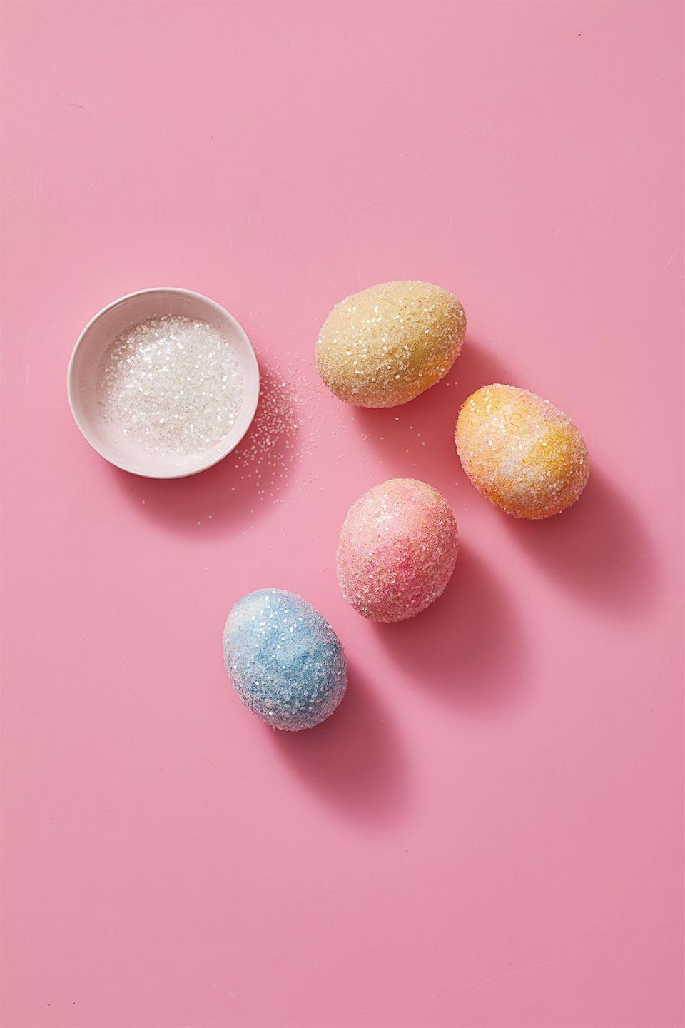 """<p>Paint one half of an egg with craft glue. Sprinkle with clear iridescent glitter and let dry. Repeat on the other side. These look beautiful on natural eggs, dyed eggs, and even other egg crafts like <a href=""""https://www.goodhousekeeping.com/holidays/easter-ideas/videos/a43272/how-to-make-marbled-easter-eggs/"""" rel=""""nofollow noopener"""" target=""""_blank"""" data-ylk=""""slk:marbled eggs"""" class=""""link rapid-noclick-resp"""">marbled eggs</a>. Note that these eggs are not edible. </p>"""