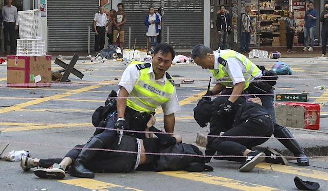 Student Chow Pak-kwan (on ground, left) was shot by police but is recovering. Photo: Nora Tam