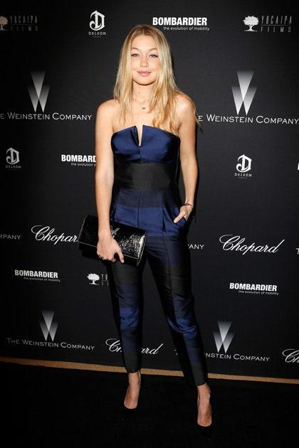 Gigi's excellence in wearing jumpsuits continued with this elegant navy and black striped number. Black pumps have become a staple in her wardrobe at this point, as have delicate bracelets and necklaces.