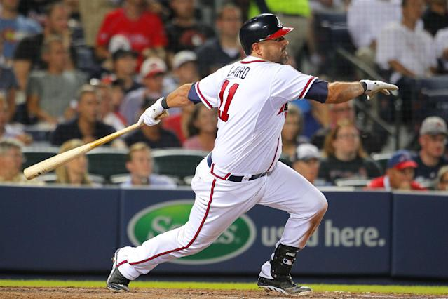 Atlanta Braves Gerald Laird hits into a double play which scored Chris Johnson in the seventh inning of a baseball game against the Philadelphia Phillies Tuesday, June 17, 2014, in Atlanta. (AP Photo/Todd Kirkland)