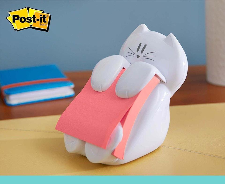 """Whether you're WFH or attending virtual school, this little feline will be there for you when you need to take a quick note or leave an encouraging message on the fridge.<br /><br /><strong>Promising review:</strong>""""I love this cute little sticky note holder! Cats are my favorite to begin with, and getting to have one on my desk to hold my notes is purr-fect. <strong>It has a great weight making it so as you pull notes from it, it doesn't move, and the bottom has rubber grips so it won't scratch any surface it will be placed on.</strong> On top of that, replacing the notes is easy since as the notes dwindle, there is a button behind that you just push in and slide the new notes over."""" —<a href=""""https://amzn.to/3eVzHso"""" target=""""_blank"""" rel=""""nofollow noopener noreferrer"""" data-skimlinks-tracking=""""5851345"""" data-vars-affiliate=""""Amazon"""" data-vars-href=""""https://www.amazon.com/gp/customer-reviews/R2E4ULH0LP33K3?tag=bfnusrat-20&ascsubtag=5851345%2C28%2C34%2Cmobile_web%2C0%2C0%2C16315211"""" data-vars-keywords=""""cleaning,fast fashion"""" data-vars-link-id=""""16315211"""" data-vars-price="""""""" data-vars-product-id=""""15938702"""" data-vars-retailers=""""Amazon"""">Unlit<br /><br /></a><strong><a href=""""https://amzn.to/3tZQM95"""" target=""""_blank"""" rel=""""noopener noreferrer"""">Get it from Amazon for$8.68.</a></strong>"""