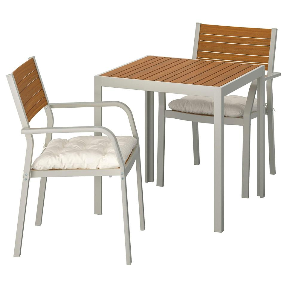 """<p>The <a href=""""https://www.popsugar.com/buy/Sj%C3%A4lland-Table-Two-Armchairs-454610?p_name=Sj%C3%A4lland%20Table%20and%20Two%20Armchairs&retailer=ikea.com&pid=454610&price=287&evar1=casa%3Aus&evar9=46226851&evar98=https%3A%2F%2Fwww.popsugar.com%2Fhome%2Fphoto-gallery%2F46226851%2Fimage%2F46226958%2FSj%C3%A4lland-Table-Two-Armchairs&list1=shopping%2Cfurniture%2Cikea%2Csummer%2Csmall%20space%20living%2Coutdoor%20decorating%2Chome%20shopping&prop13=api&pdata=1"""" class=""""link rapid-noclick-resp"""" rel=""""nofollow noopener"""" target=""""_blank"""" data-ylk=""""slk:Själland Table and Two Armchairs"""">Själland Table and Two Armchairs</a> ($287) comes in multiple shade ranges to suit your style.</p>"""