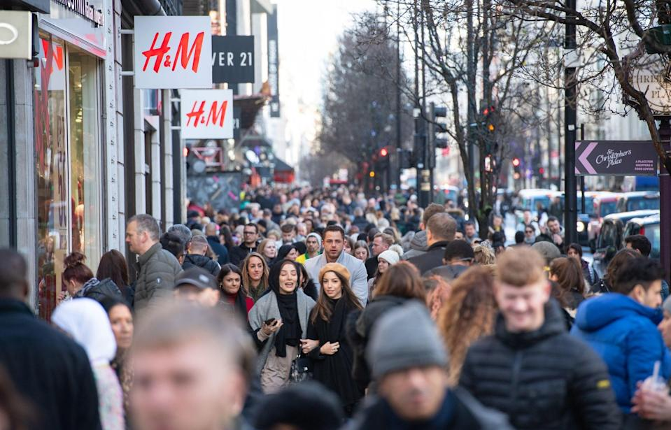 <p>Shoppers on Oxford Street</p>PA