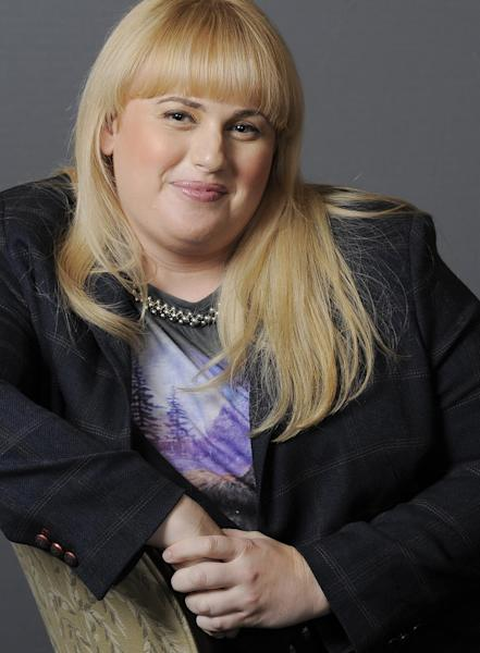 """In this Thursday, Aug. 23, 2012 photo, actress, writer and comedienne Rebel Wilson, a cast member in the film """"Bachelorette,"""" poses for a portrait at the Four Seasons Hotel in Beverly Hills, Calif. She may have already caught your eye with her brief appearance in """"Bridesmaids,"""" playing the freeloading roommate who reads Annie's (Kristen Wiig) diary after mistaking it for """"a very sad, handwritten book."""" The 28-year-old Australian actress' scene-stealing turn in the 2011 hit certainly got Hollywood's attention. (Photo by Chris Pizzello/Invision/AP)"""