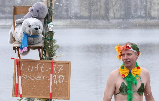 BERLIN, GERMANY - JANUARY 12: An ice swimming enthusiast prepares to enter the cold waters of Orankesee lake next to a sign displaying air and water temperatures during the 'Winter Swimming in Berlin' event on January 12, 2013 in Berlin, Germany. A local swimmers' group called the 'Berlin Seals' invite ice swimmers from across Germany and abroad to the annual event, which, despite warmer temperatures this winter and a lack of ice, was still held. Members claim ice swimming is good for the body's blood circulation. (Photo by Adam Berry/Getty Images)