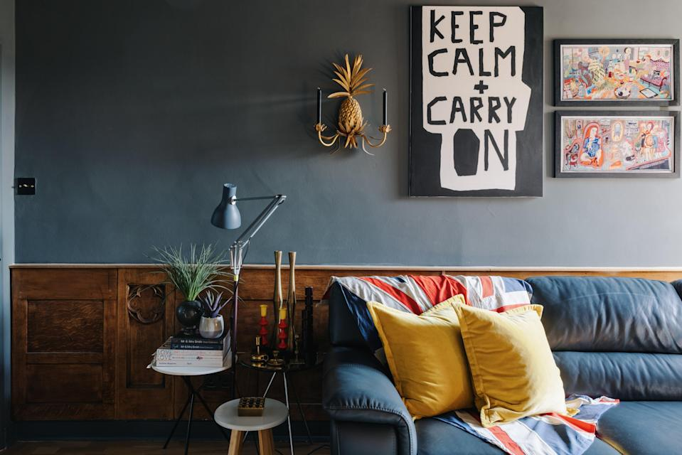 A Union flag motif and pineapple wall sconces inject quirky British style into the living room (Mark Anthony Fox)