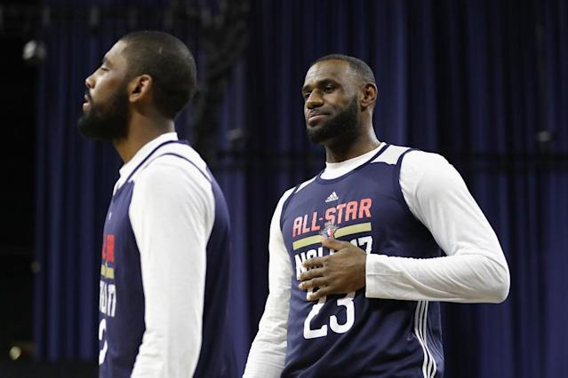 LeBron James eyes Kyrie Irving. (Getty Images)