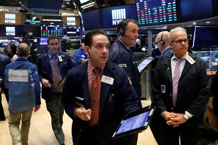 Dow breaches 26000 mark on good earnings