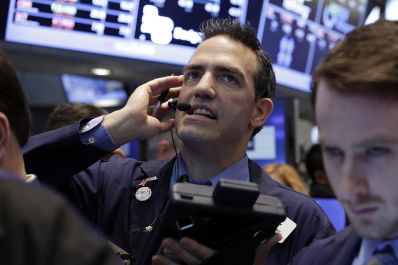 Trader Gregory Rowe works on the floor of the New York Stock Exchange Thursday, May 23, 2013. A global stock market slump is continuing on Wall Street as traders worry about how committed the Federal Reserve remains to keeping up its bond-buying program. (AP Photo/Richard Drew)