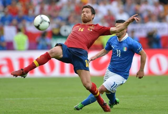 Spanish midfielder Xabi Alonso (L) vies with Italian forward Antonio Di Natale during the Euro 2012 championships football match Spain vs Italy on June 10, 2012 at the Gdansk Arena. AFPPHOTO/ GIUSEPPE CACACEGIUSEPPE CACACE/AFP/GettyImages
