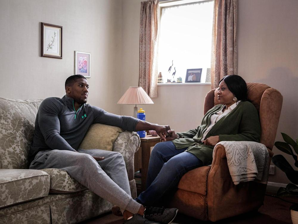 The heavyweight boxer at home with his mother, Yeta: Getty