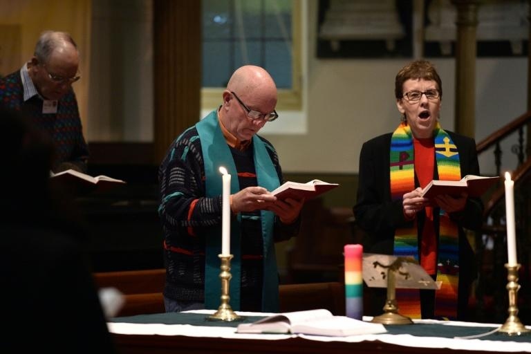 Reverend Margaret Mayman (R), minister of the Pitt Street Uniting Church, heads a Sunday service in Sydney