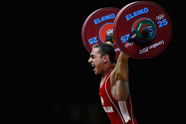 LONDON, ENGLAND - JULY 29: Valentin Hristov of Azerbaijan competes in the Men's 56kg Weightlifting on Day 2 of the London 2012 Olympic Games at ExCeL on July 29, 2012 in London, England. (Photo by Laurence Griffiths/Getty Images)