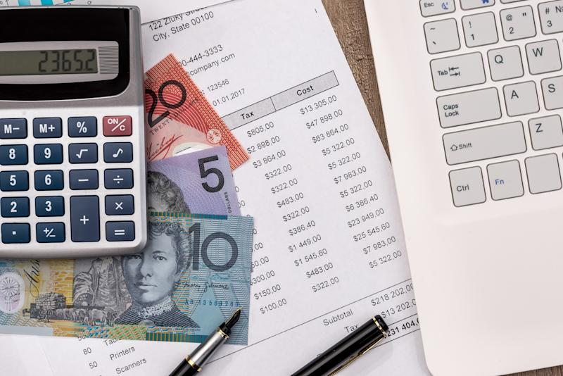 australian dollar with graph, home budget laptop and calculator