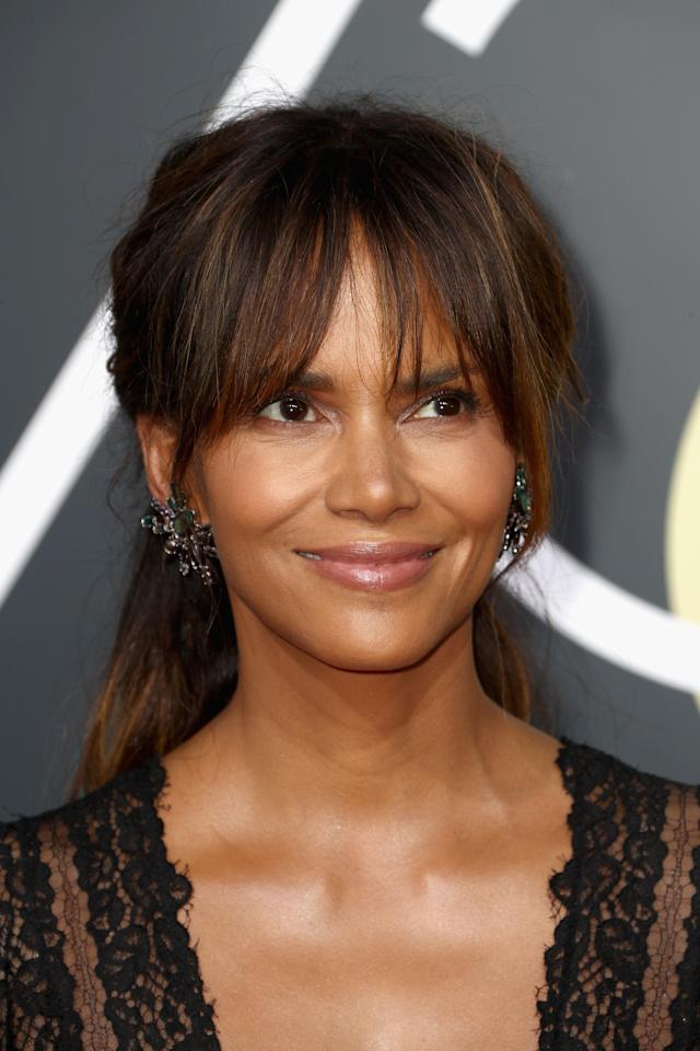 Halle Berry attends the 75th annual Golden Globe Awards in emerald earrings. (Photo: Getty Images)