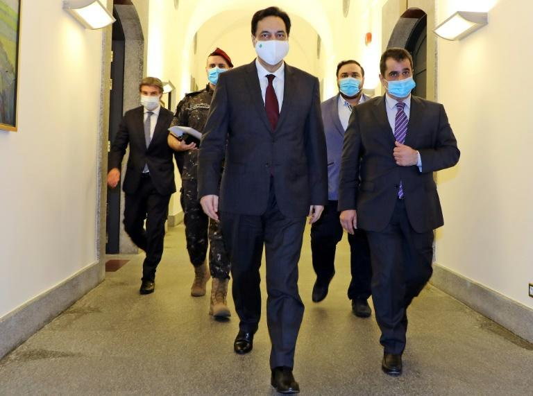 Diab pictured in June wearing a face mask due to the COVID-19 pandemic ahead of an emergency cabinet session