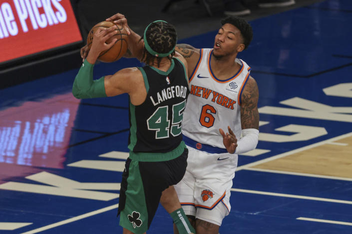 Boston Celtics guard Romeo Langford (45) drives to the basket as New York Knicks guard Elfrid Payton (6) defends during the second half of an NBA basketball game in New York, Sunday, May 16, 2021. (Vincent Carchietta/Pool Photo via AP)