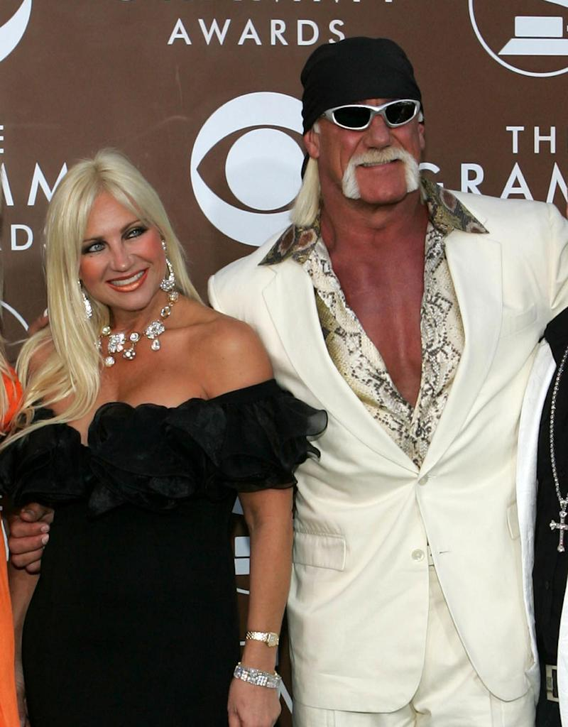 FILE - In this Feb. 8, 2006 file photo, Hulk Hogan and his wife Linda arrive at the 48th annual Grammy Awards, in Los Angeles. Court records show a financial settlement has been agreed upon between wrestler Terry Bollea, better known as Hulk Hogan, and his ex-wife Linda. The St. Petersburg Times reports Linda Bollea received a little more than 70 percent of the couple's liquid assets in their divorce settlement. (AP Photo/Chris Carlson, file)