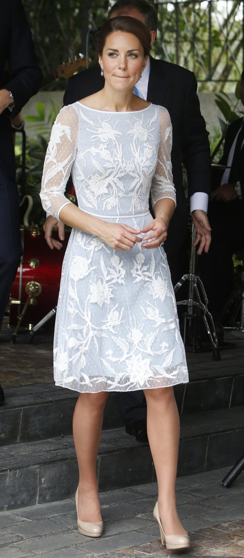 <p>Kate attended a tea party in Kuala Lumpur in an ice blue Temperley dress. Featuring elegant white embroidery, she wore nude L.K. Bennett heels. </p><p><i>[Photo: PA]</i></p>