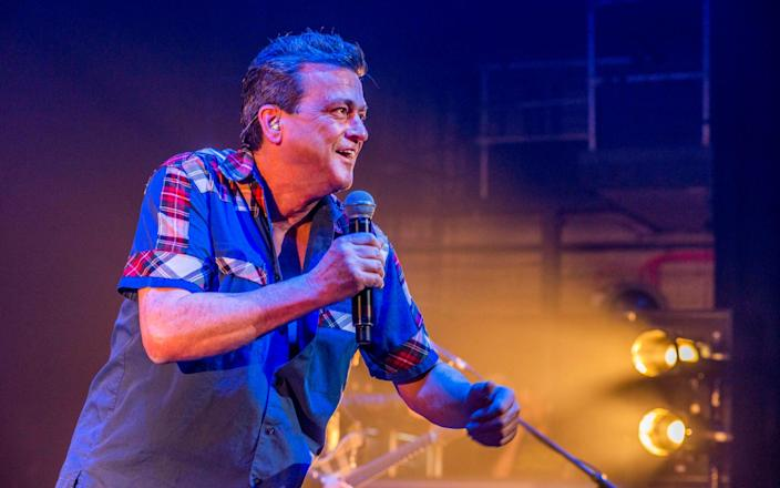 Les McKeown of the Bay City Rollers on stage at the Eventim Apollo, Hammersmith, London, December 2016 - Dick Barnatt/Redferns