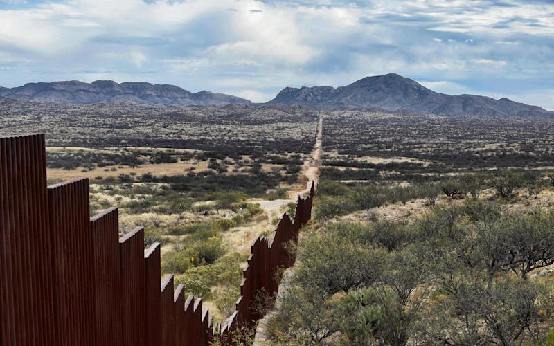 View of the border line between Mexico and the U.S in the community of Sasabe in Sonora state, Mexico, on January 13, 2017. Hundreds of Central American and Mexican migrants attempt to cross the US border daily. - Credit: ALFREDO ESTRELLAALFREDO ESTRELLA/AFP or licensors